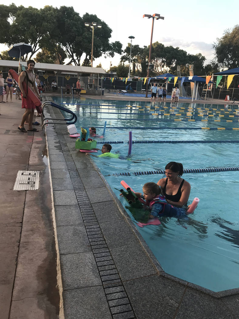 Hali Bernstein Saylor/Boulder City Review Children in the 6 and younger age division reach the finish line after racing their entries in the 18th annual cardboard boat races at the Boulder City Po ...