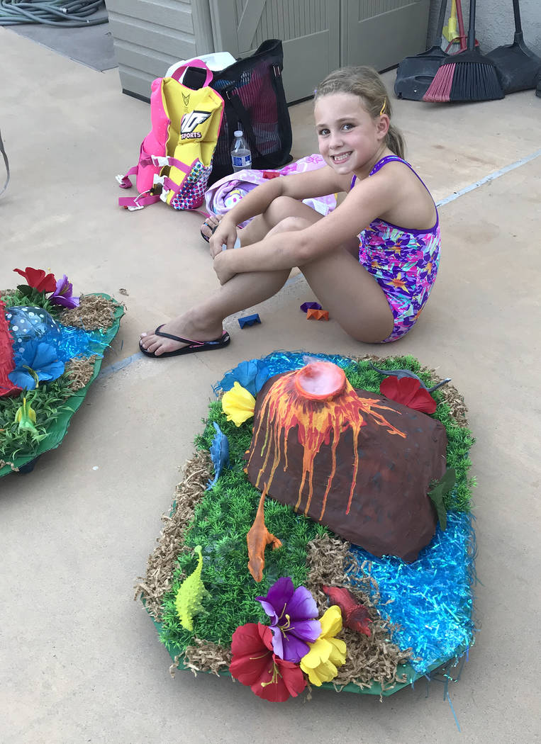 Hali Bernstein Saylor/Boulder City Review Seven-year-old Taylor Reeves' Smoky the Great volcano entry, which spewed smoke thanks to the use of dry ice, won first place for the best movie depiction ...