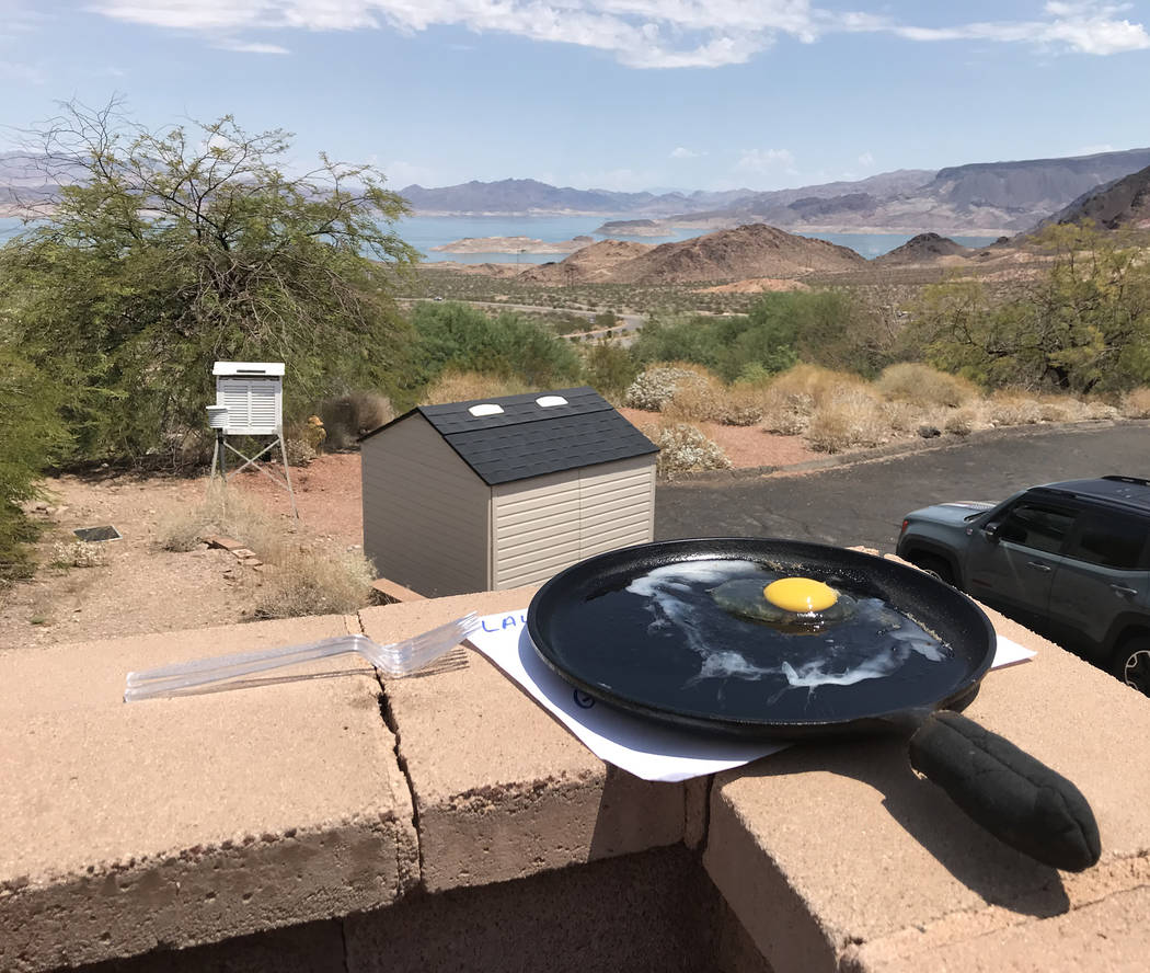 Hali Bernstein Saylor/Boulder City Review After just 15 minutes outside July 26 during an excessive heat warning, an egg began to show signs of cooking outside the Alan Bible Visitor Center at Lak ...