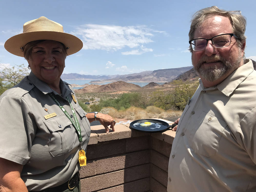 Hali Bernstein Saylor/Boulder City Review As temperatures climbed past 111 degrees July 26 during an excessive heat warning, Marty Peterson, right, a volunteer at the Alan Bible Visitor Center at ...