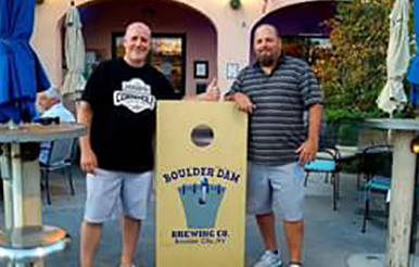 John Langley Mark Speegs, left, of 702 Cornhole and John Langley of Boulder City Cornhole League stand beside a cornhole platform in front of Boulder Dam Brewing Co. where the league will hold it ...