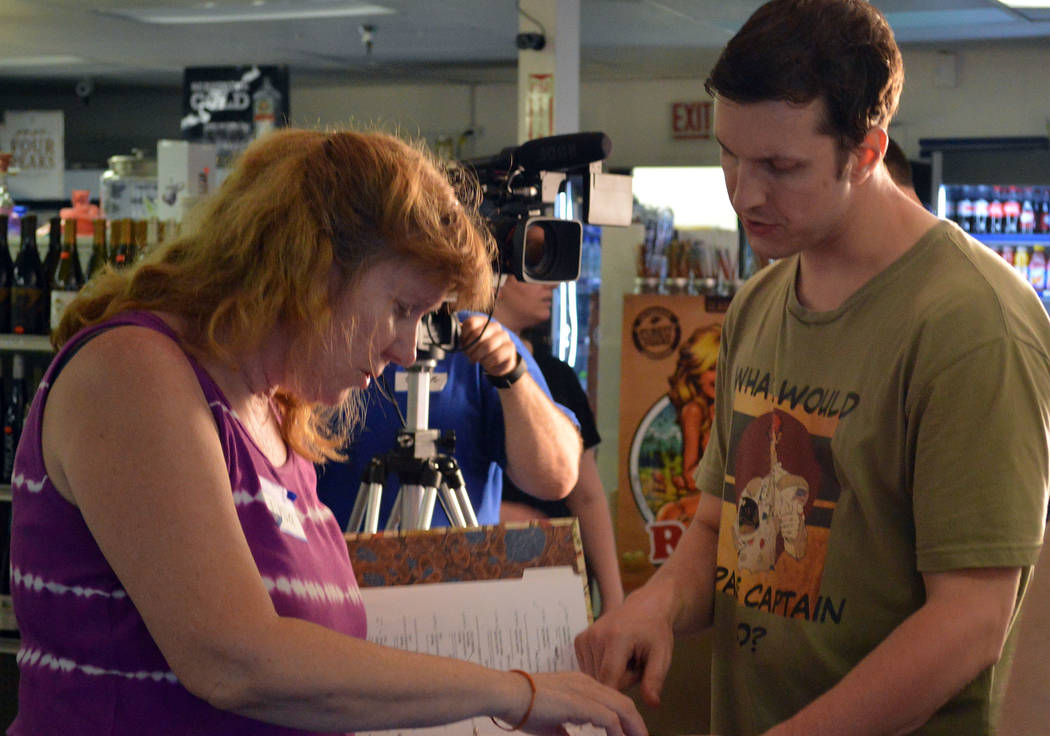 """Celia Shortt Goodyear/Boulder City Review Local writer and producer Lisa Savy goes over the script for her movie """"Space Captain and Callista"""" at BC Liquor, 806 Buchanan Blvd., with Las Vegas actor ..."""