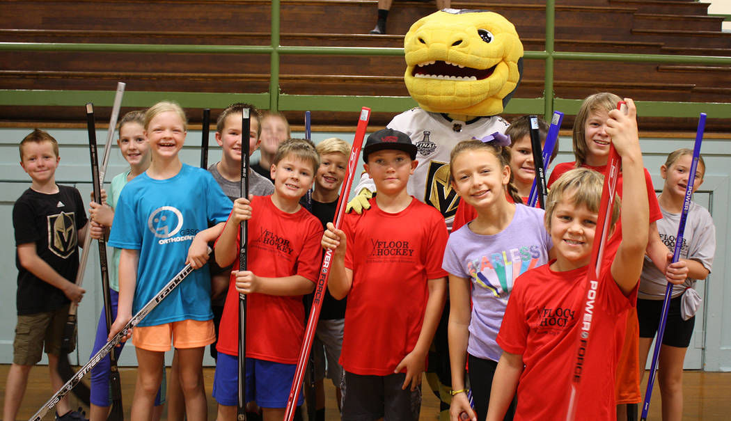 Kelly Lehr, Chance, the Golden Knights Hockey team mascot, came out to play with local children at a free clinic to last season's floor hockey participants on July 31. The Knights organization d ...