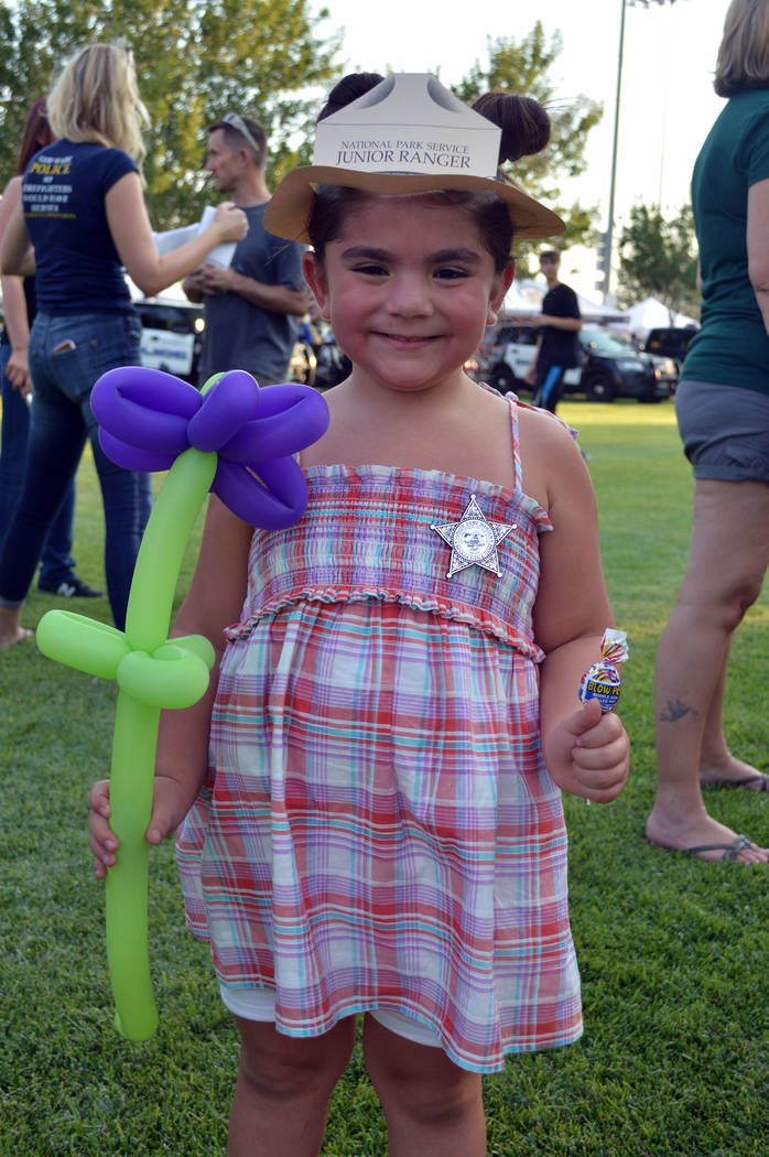 Celia Shortt Goodyear/Boulder City Review Leora Rose shows off her junior ranger hat and badge she received at National Night Out on Tuesday at Veterans' Memorial Park in Boulder City.