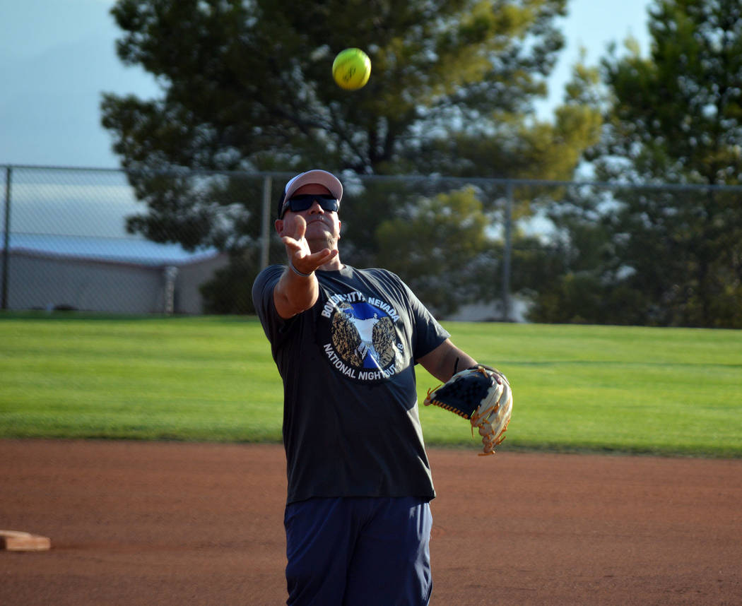 Celia Shortt Goodyear/Boulder City Review Boulder City Police officer Dave Krumm throws a first-inning pitch at the annual National Night Out softball game Tuesday at Veterans' Memorial Park in Bo ...