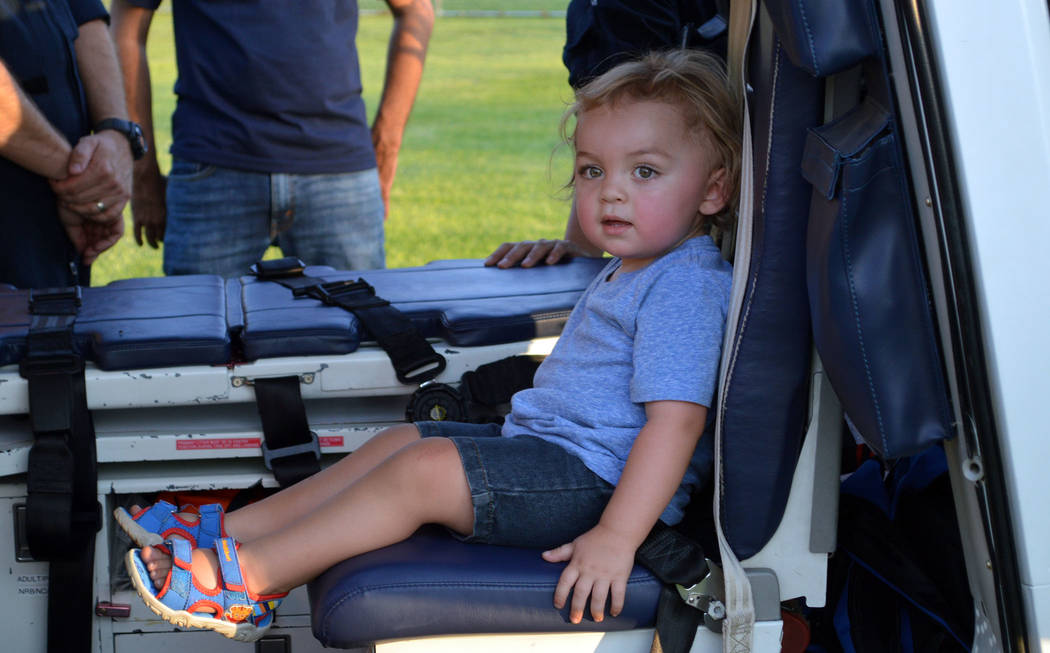 Celia Shortt Goodyear/Boulder City Review Jace Chatwin tries out a helicopter at National Night Out on Tuesday at Veterans' Memorial Park in Boulder City.