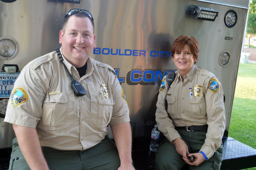 Celia Shortt Goodyear/Boulder City Review Boulder City Animal Control officer Brendan Hanson and animal control Supervisor Ann Inabnitt enjoy the shade during Boulder City's National Night Out on ...