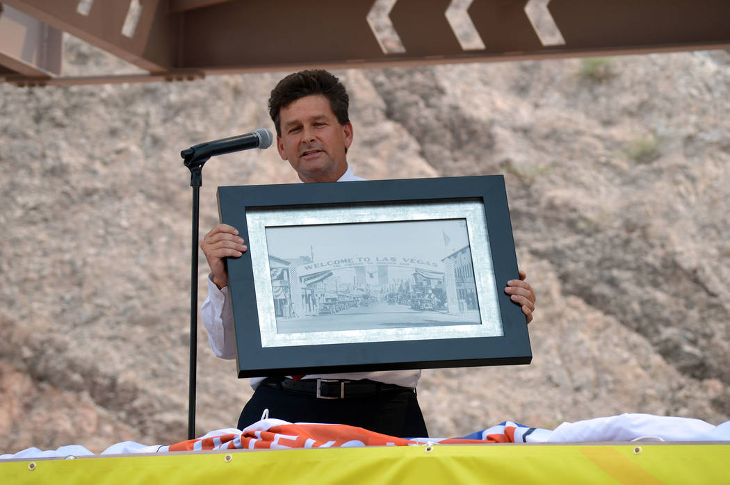Celia Shortt Goodyear/Boulder City Review Boulder City Mayor Rod Woodbury highlights the history of the town and the Hoover Dam during Interstate 11's grand opening ceremony Aug. 9.