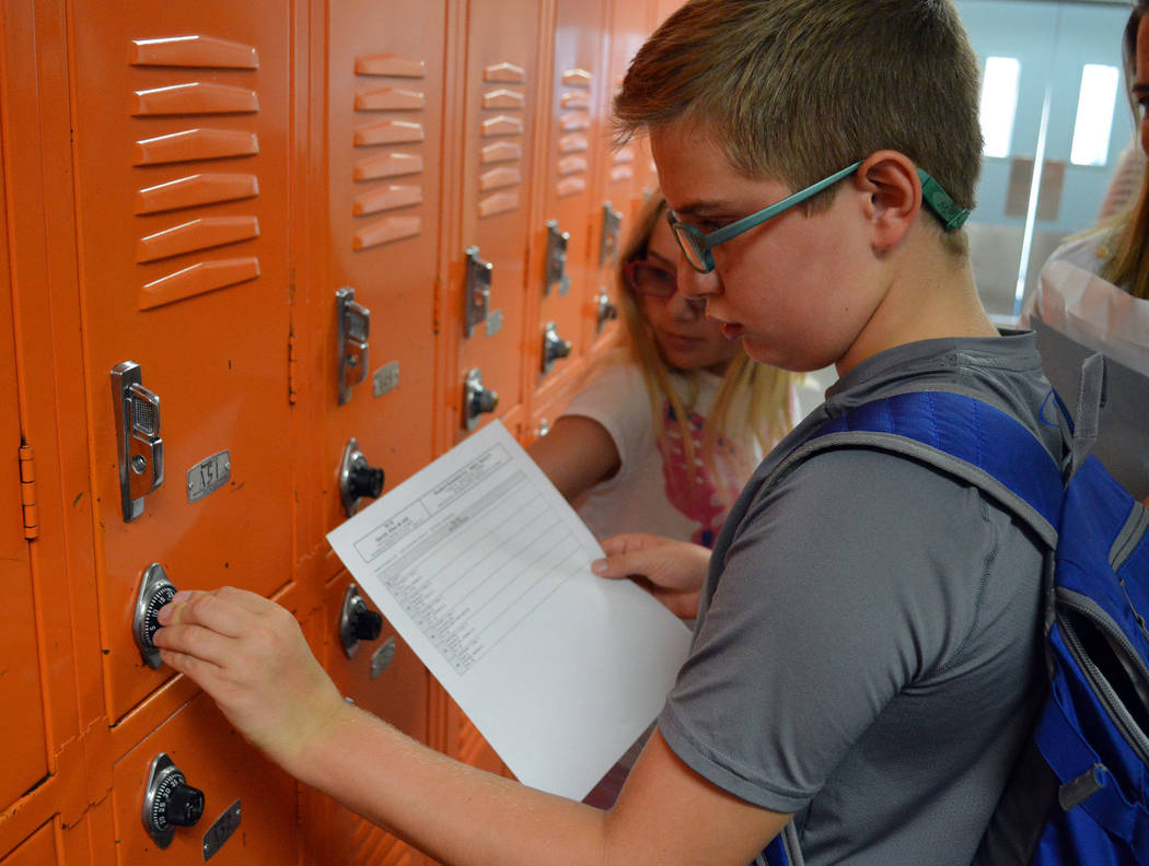 Celia Shortt Goodyear/Boulder City Review Sixth-grader Hank Stark opens his locker at Garrett Junior High School for the first time at the back-to-school event Friday.