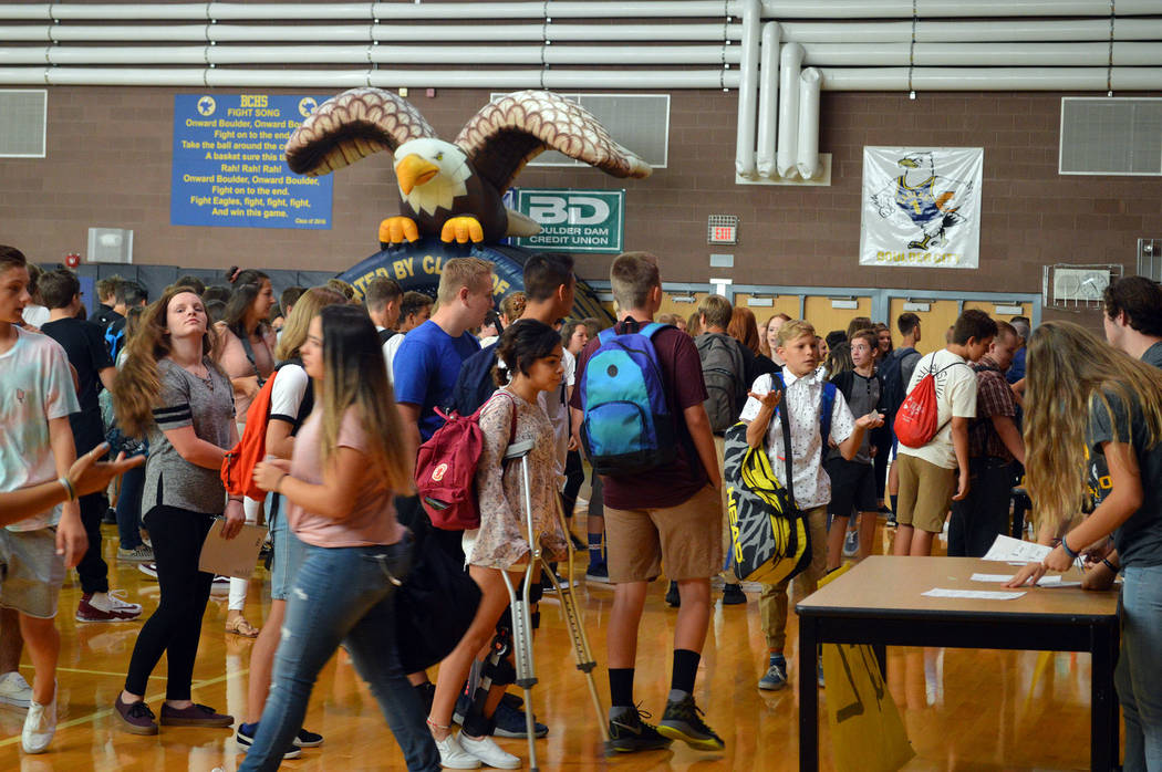 Celia Shortt Goodyear/Boulder City Review Freshmen line up in the Boulder City High School gymnasium on Monday for their orientation on the first day of school.