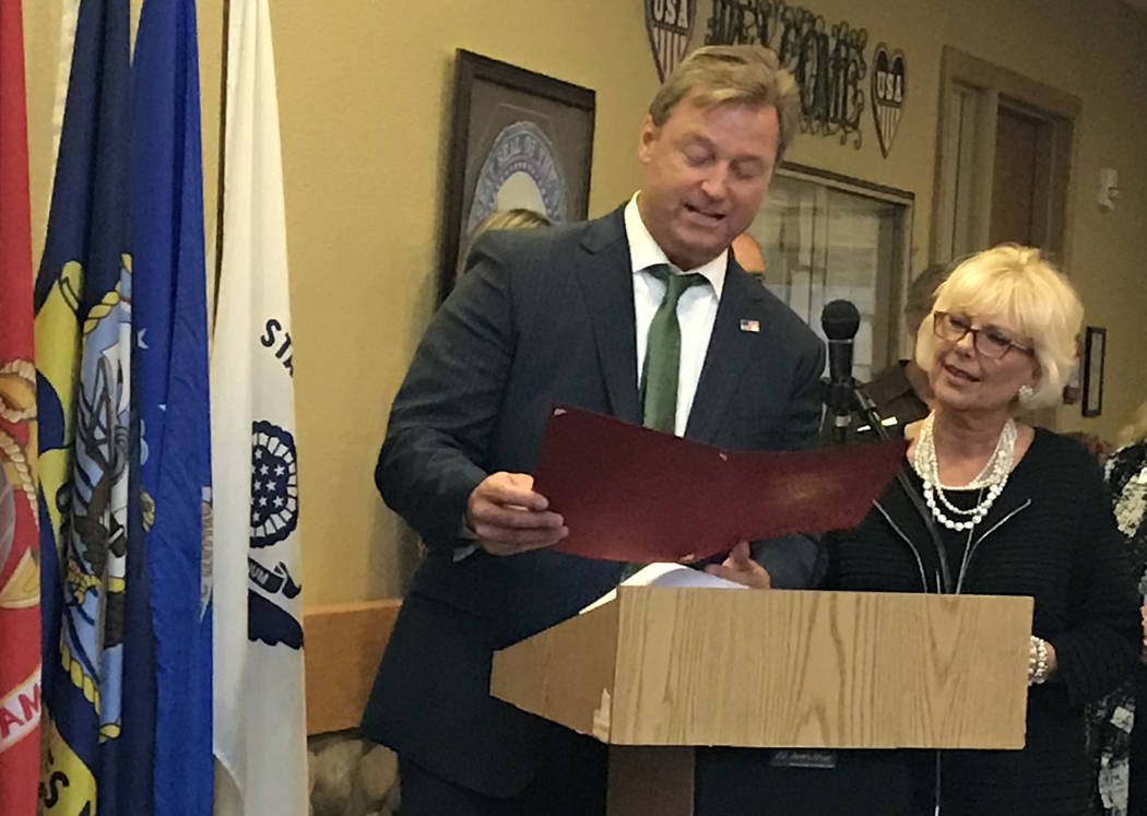 Hali Bernstein Saylor/Boulder City Review Sen. Dean Heller reads a certificate congratulating the Nevada State Veterans Home in Boulder City on its 16th anniversary and accomplishments of the past ...