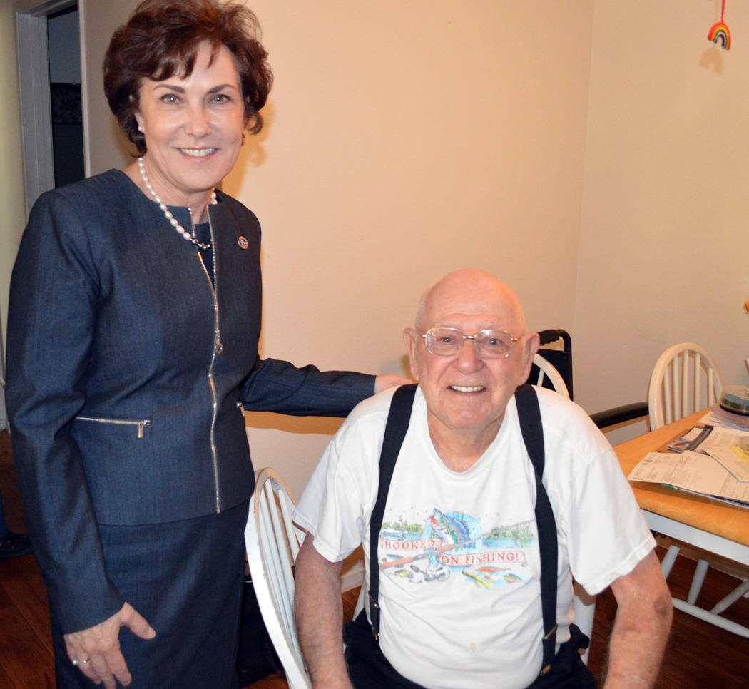 Celia Shortt Goodyear/Boulder City Review U.S. Rep. Jacky Rosen visits Boulder City resident Dick Olson on Aug. 16. She delivered his food with Meals on Wheels.