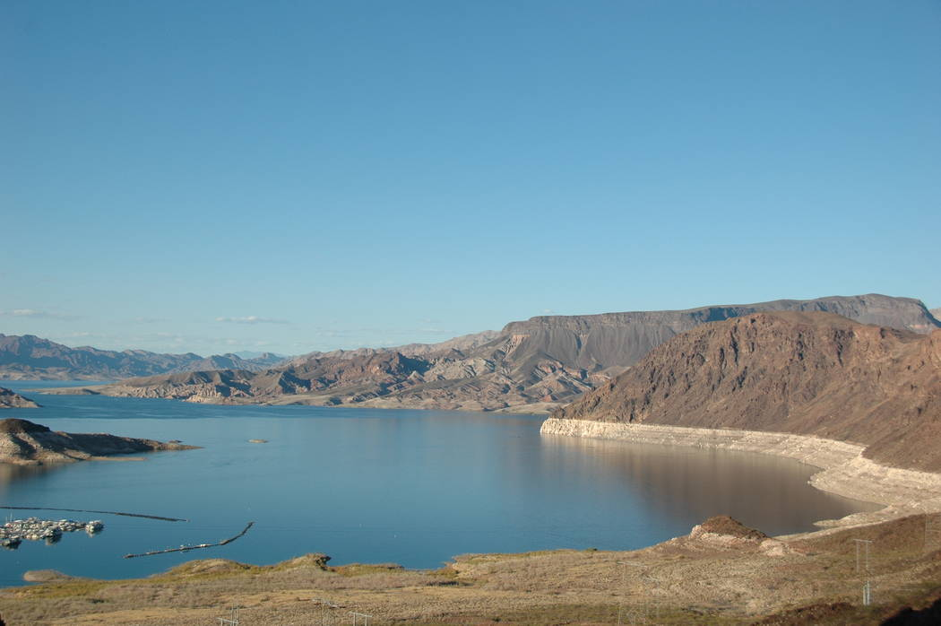 File Federal projections expect the water in Lake Mead to remain above the level that would trigger a mandatory cuts, at least for this year.