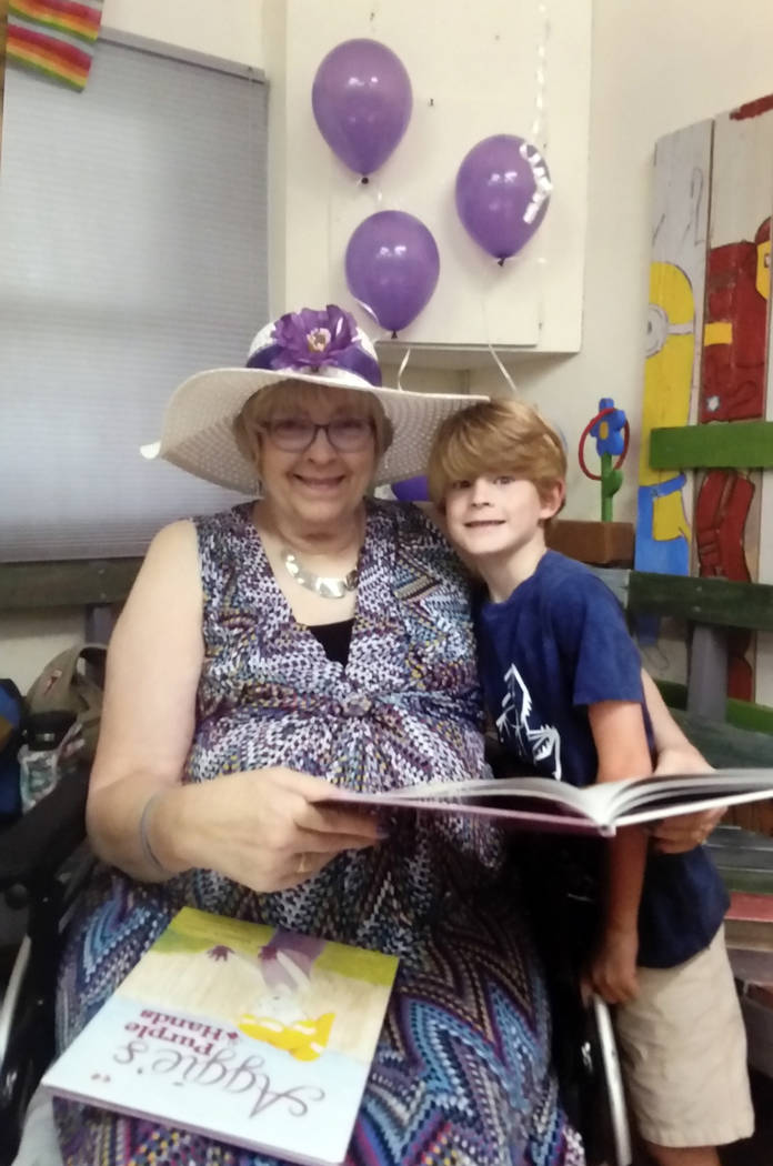 "Rhonda Gatlin Author Rhonda Gatlin reads her new book, ""Aggie's Purple Hands,"" with her grandson, Oliver Osbourn, at at a book signing Aug. 2 at Ruben's Wood Craft and Toys in Boulder City."