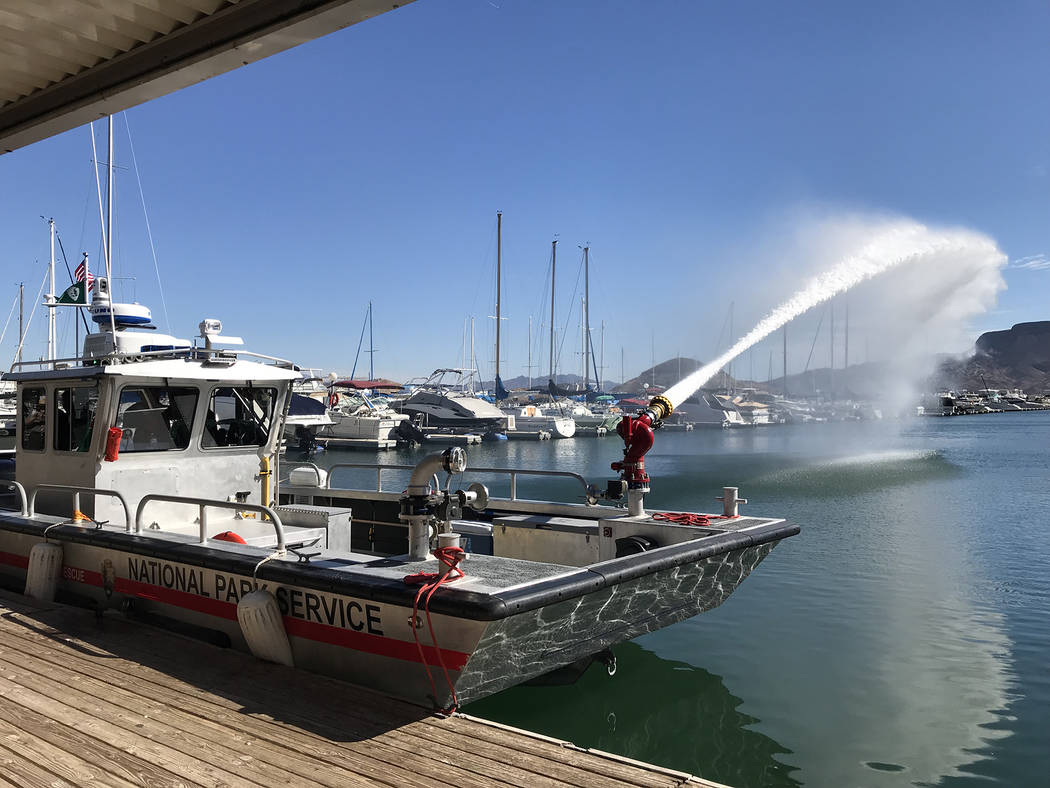 Hali Bernstein Saylor/Boulder City Review Rangers at Lake Mead National Recreation Area demonstrate how water can be pumped from its new fireboat during a dedication ceremony Friday.