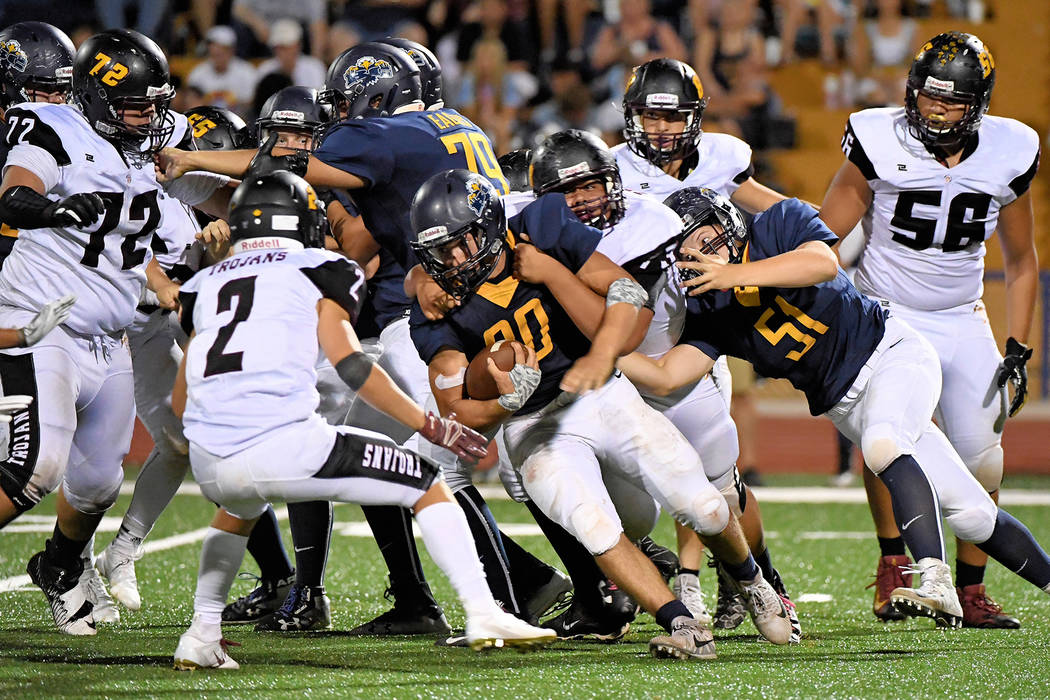 Peter Davis/Boulder City Review Boulder City High School's Thorsten Balmer, center, proves to be tough to take down. The senior rushed for 211 yards during Friday's game against Pahrump.