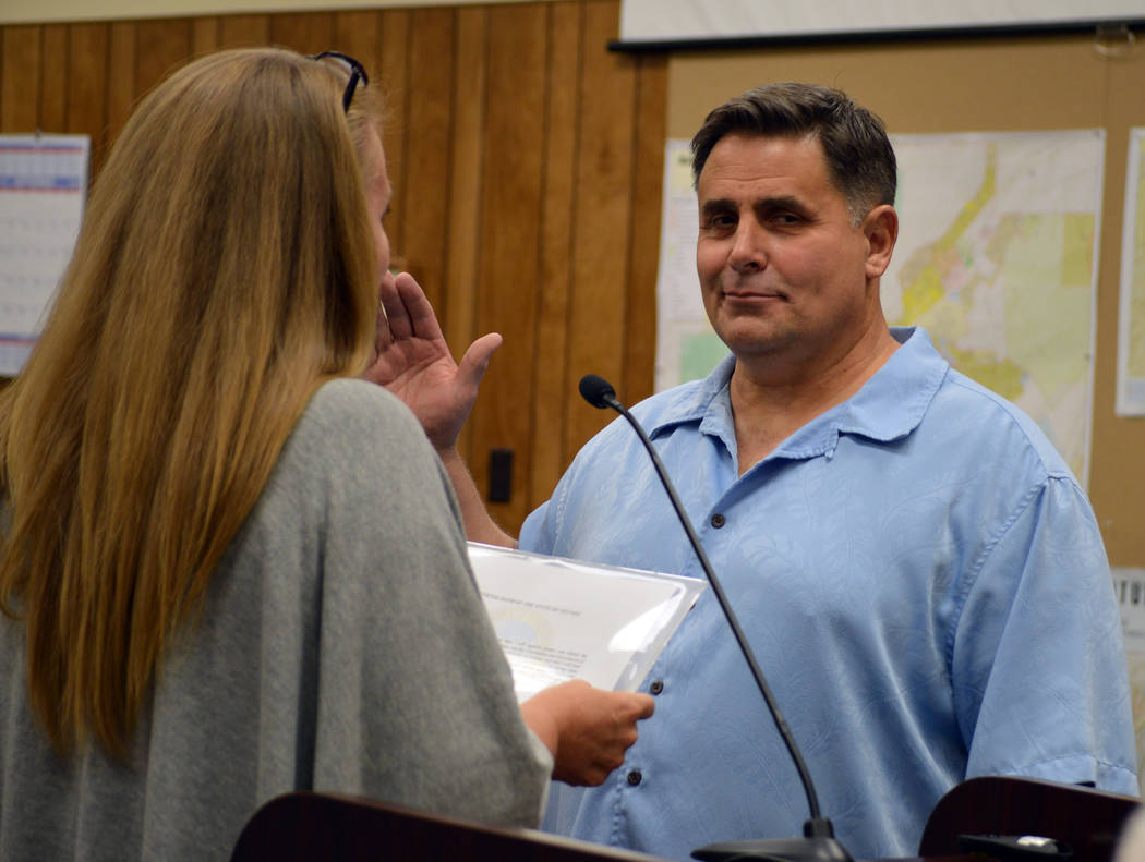 Celia Shortt Goodyear/Boulder City Review Bill Wilson is sworn into the Parks and Recreation Commission by City Clerk Lorene Krumm at the City Council meeting Tuesday, Sept. 11.