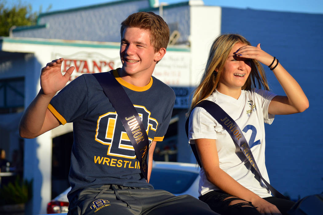 Celia Shortt Goodyear/Boulder City Review Boulder City High School's junior homecoming court, Ladd Cox and Sydney Adams, wave during the 2018 homecoming parade in downtown Boulder City on Sept. 13.