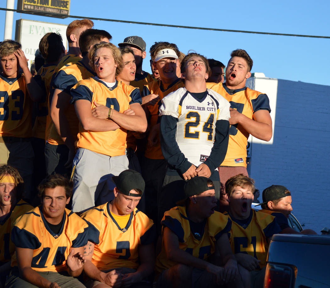 Celia Shortt Goodyear/Boulder City Review Members of the Boulder City High School football team cheer and chant during the 2018 homecoming parade in downtown Boulder City on Sept. 13.