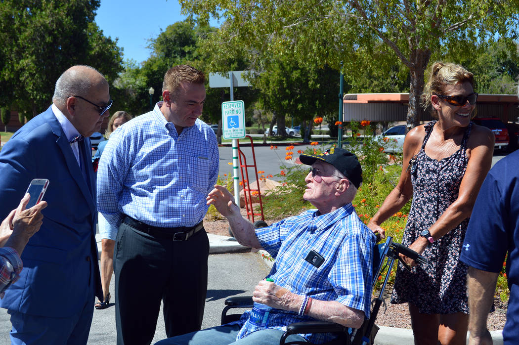Celia Shortt Goodyear/Boulder City Review City Councilman Warren Harhay, from left, and City Manager Al Noyola listen to World War II veteran William Dunsmore, who is being helped by his granddaug ...