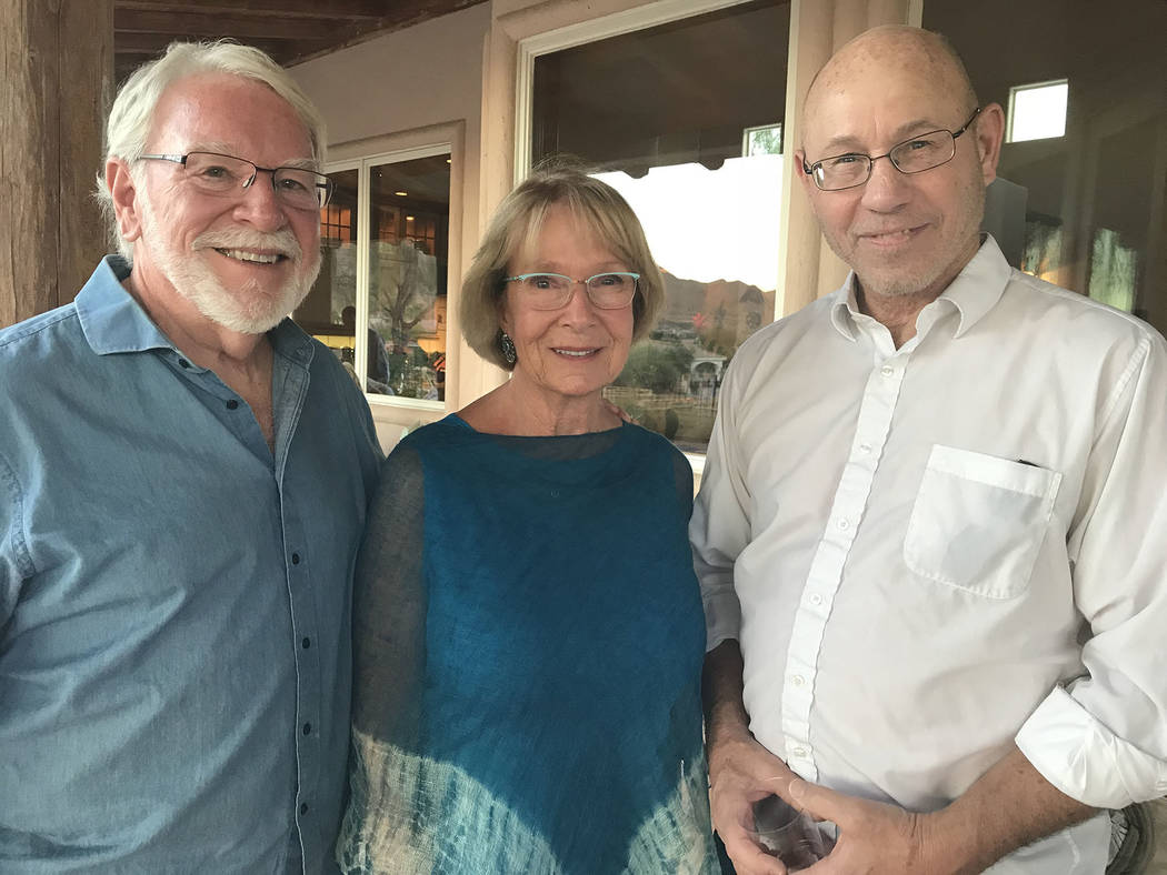 Hali Bernstein Saylor/Boulder City Review Chautauqua scholar Doug Mishler, right, visits with Jim Amstutz and Linda Faiss, who hosted a special event Friday at their home to meet the University of ...