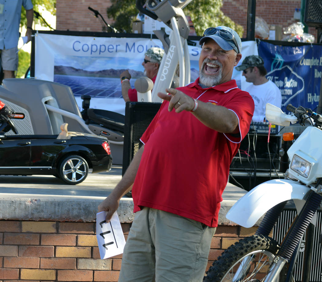 File Scott Hinson spots a bid during the live auction during the Boulder City Sunrise Club's 21st annual Wurst Festival in 2017. This year's festival starts at 10 a.m. Saturday.