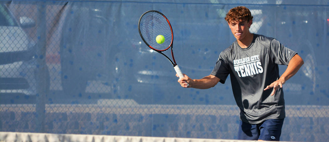 Robert Vendettoli/Boulder City Review Boulder City High School junior doubles player Preston Jorgensen returns a serve from Moapa Valley on Monday. He and partner, Boen Huxford, went 3-0 for the day.