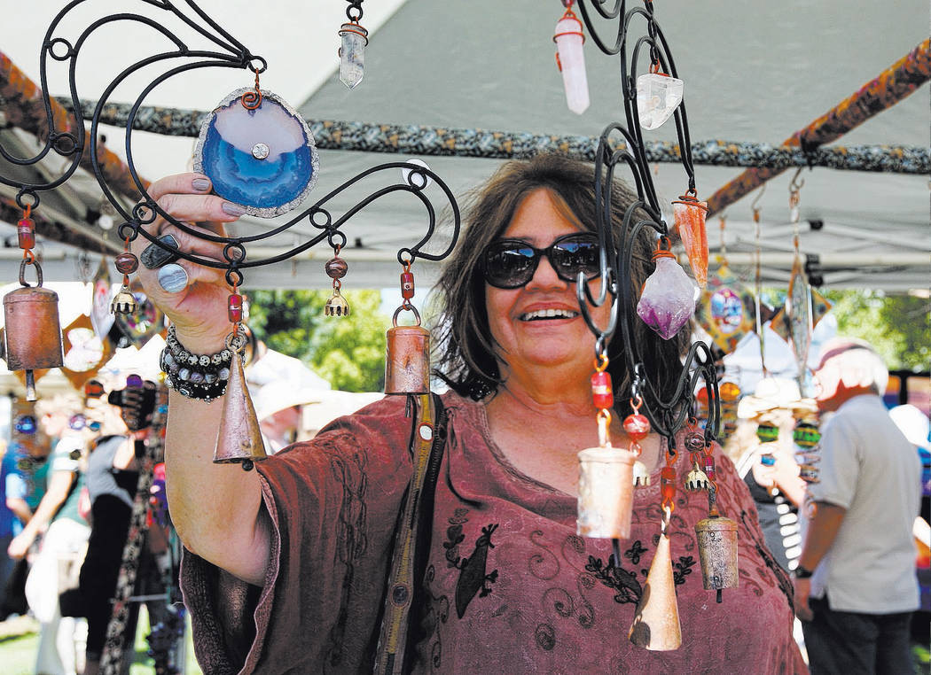 Kay Koning looks at handmade wind chimes during the 2017 Art in the Park festival in Boulder City's downtown parks. This year's festival will be held from 9 a.m. to 5 p.m. Saturday and Sunday.