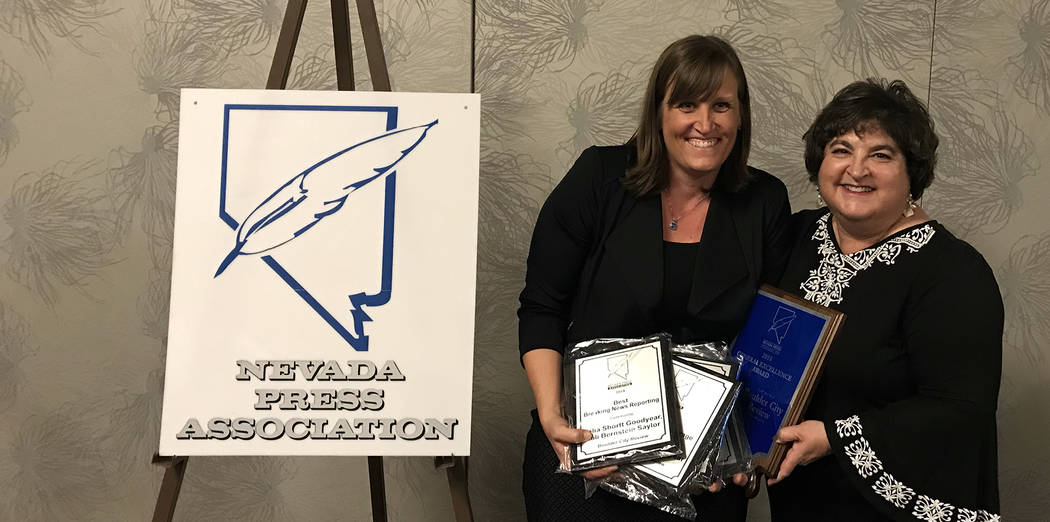 Boulder City Review Reporter Celia Shortt Goodyear, left, and Editor Hali Bernstein Saylor show off a few of the 20 awards they and staff from the Boulder City Review won at the 2018 Better Newspa ...
