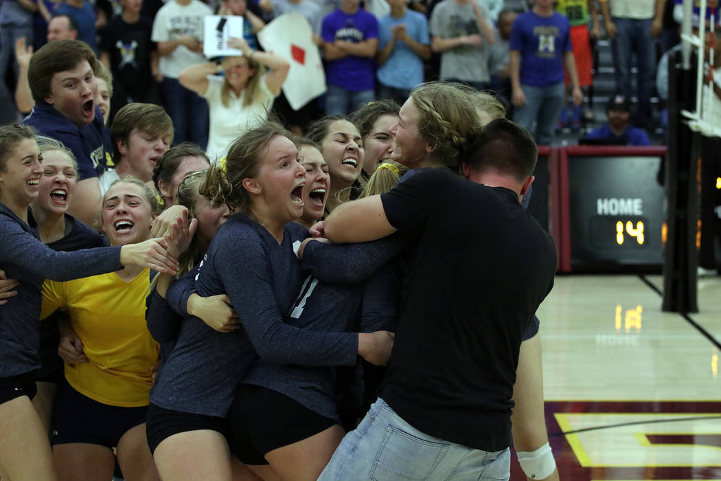 File This photo of Boulder City High School's girls varsity volleyball team celebrating their state championship win, taken by former Boulder City High School yearbook adviser Canaan Peterson, won ...