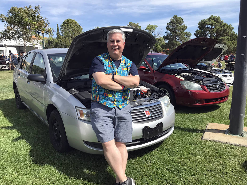 Hali Bernstein Saylor Jeff Breeden, president of the Boulder City Sunrise Rotary, takes a break from the activities at Saturday Wurst Festival to check out a few of the vehicles that were set to b ...