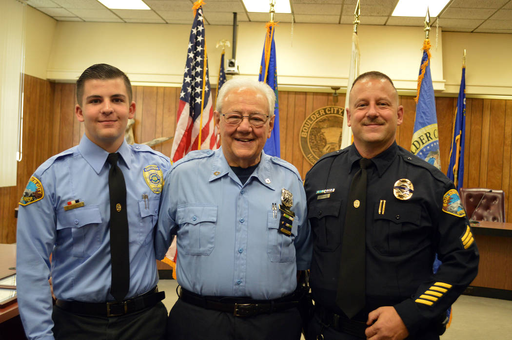 Celia Shortt Goodyear/Boulder City Review Craig Tomao, right, was sworn in as a Boulder City Police sergeant on Monday, Oct. 1, at City Hall. Attending the ceremony were his son, Domenic, left, a ...