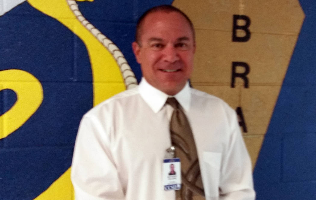 Celia Shortt Goodyear/Boulder City Review King Elementary School Principal Anthony Gelsone shows off his new haircut in celebration of the school's new four star rating by the state. He promised t ...