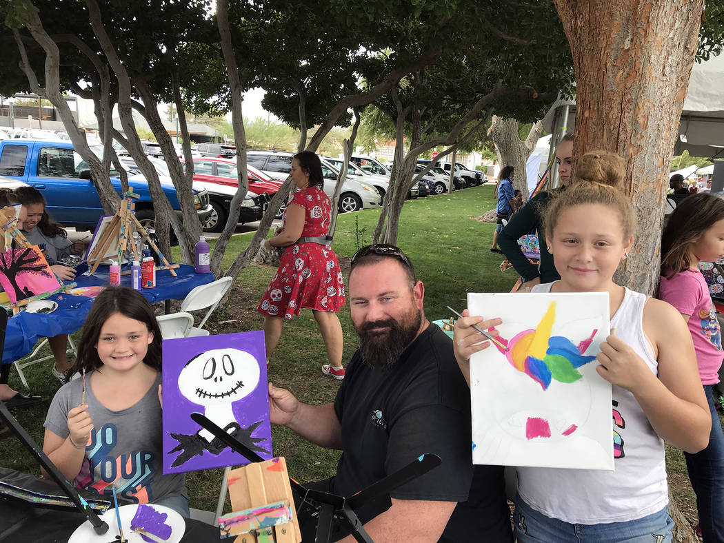 Hali Bernstein Saylor/Boulder City Review Art in the Park offered attendees the chance to create their own works. Here, Boulder City residents Braylin Bagley, 7, from left, Paul Bagley and Mikayla ...