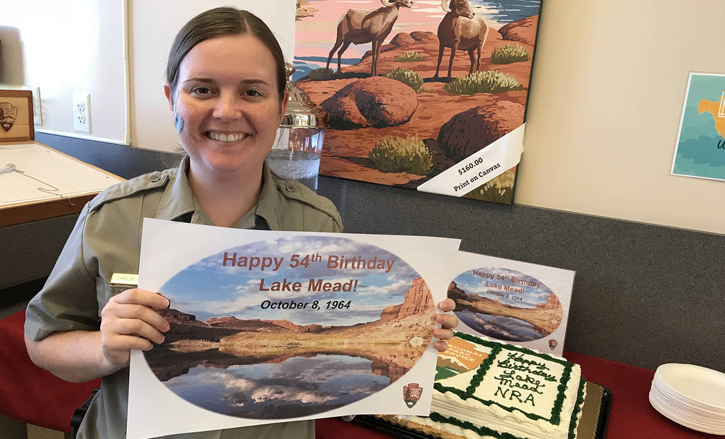 Hali Bernstein Saylor/Boulder City Review Chelsy Jackson, a ranger at Lake Mead National Recreation Area, helps the park celebrate its 54th birthday Monday, Oct. 8, 2018. Cake was served and visit ...