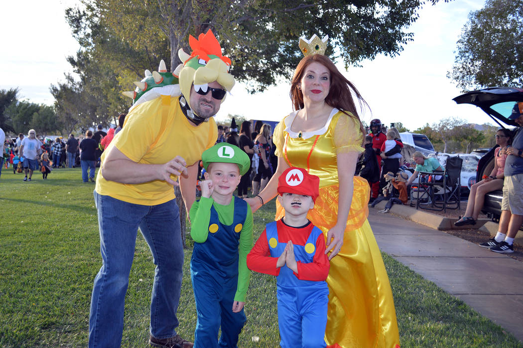 Celia Shortt Goodyear/Boulder City Review The Hallam family came to Boulder City Chamber of Commerce's annual Trunk or Treat on Oct. 13. Amanda Hallam, right, said the boys wanted them all to dre ...