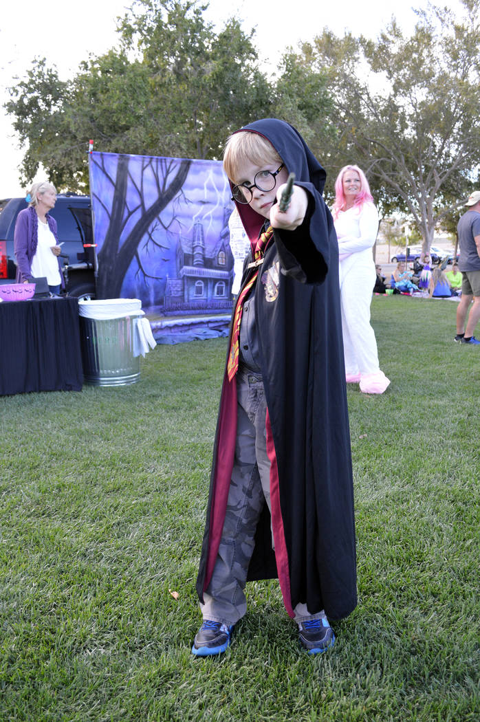 Celia Shortt Goodyear/Boulder City Review Gavin Donohue casts a spell as Harry Potter at Trunk or Treat on Saturday, Oct. 13, at Veterans' Memorial Park.