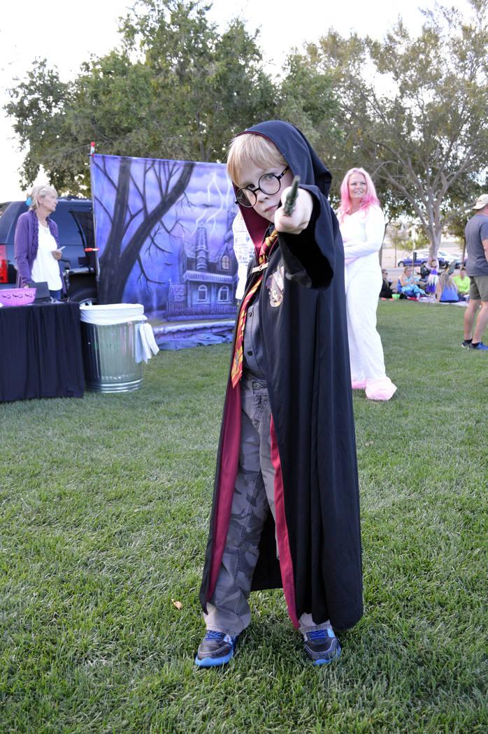 Celia Shortt Goodyear/Boulder City Review Gavin Donohue casts a spell as Harry Potter at Trunk or Treat on Saturday, Oct. 13, at Veterans' Memorial Park.