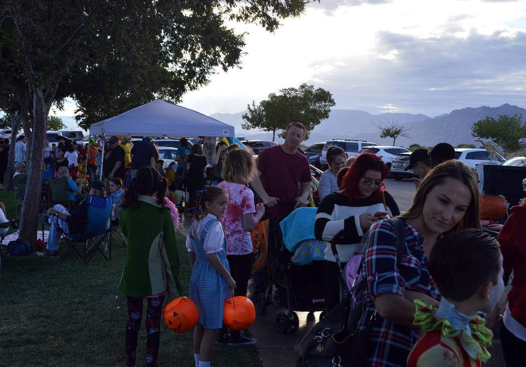 Celia Shortt Goodyear/Boulder City Review Parents and children fill Veterans' Memorial Park on Saturday, Oct. 13, for the annual Trunk or Treat celebration.