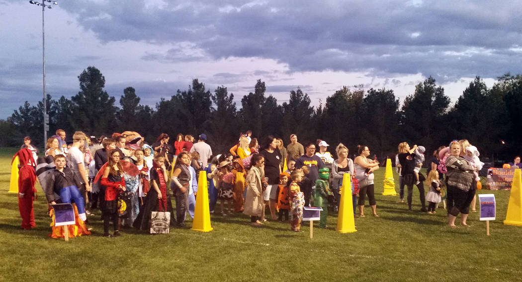 Celia Shortt Goodyear/Boulder City Review Children and their parents line up for the costume contest at Trunk or Treat on Saturday, Oct. 13, in Veterans' Memorial Park. One of the costumes stirred ...