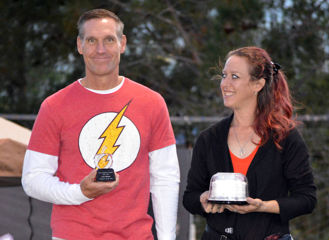 Celia Shortt Goodyear/Boulder City Review Brina Marcus presents Scott Hansen with the Boulder City Chamber of Commerce's 2018 Eva McGarvey Award for outstanding service during Trunk or Treat on Sa ...