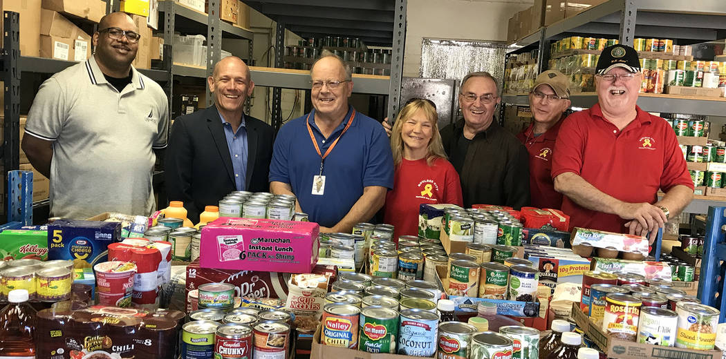 Hali Bernstein Saylor/Boulder City Review Bureau of Reclamation employees gathered 7,850 pounds of food during a 10-week campaign to help Emergency Aid of Boulder City. Terry Fulp, regional direct ...