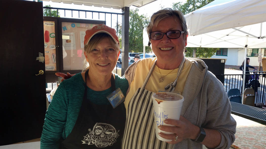 Celia Shortt Goodyear/Boulder City Review Chris Ward, left, and Nancy Loudin package pints of chili on Friday, Oct. 19, to sell at the 71st annual Country Store hosted by Grace Community Church. L ...
