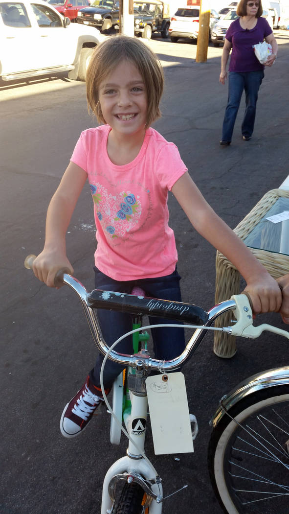 Celia Shortt Goodyear/Boulder City Review Kathryn McPhersion tries out a bike on Friday, Oct. 19, at Grace Community Church's 71st annual Country Store.