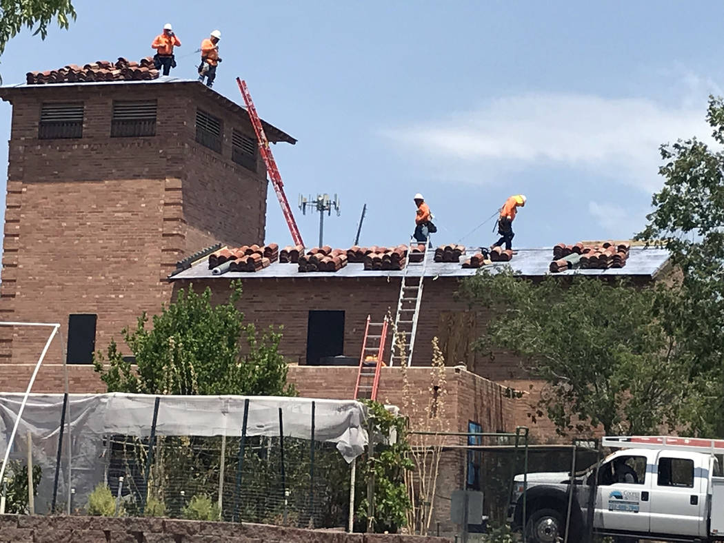 Hali Bernstein Saylor/Boulder City Review Earlier this year, workers installed a new roof on the water filtration plant on Railroad Avenue. More than 100 tiles were salvaged and two local nonprof ...
