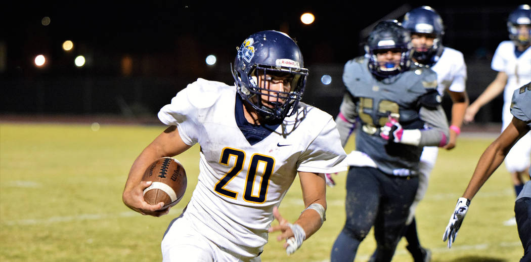 Robert Vendettoli/Boulder City Review Boulder City High School senior running back Thorsten Balmer dashes up field for a first down against Sunrise Mountain on Friday, Oct. 19. Balmer rushed for f ...