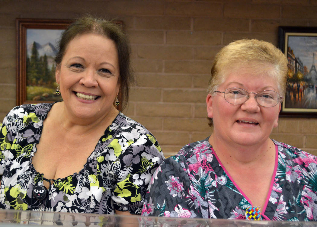 Celia Shortt Goodyear/Boulder City Review Elsie Callaway, left, and Bertha Bell dished out ice cream Friday, Oct. 26, at the Senior Center of Boulder City's ice cream social.