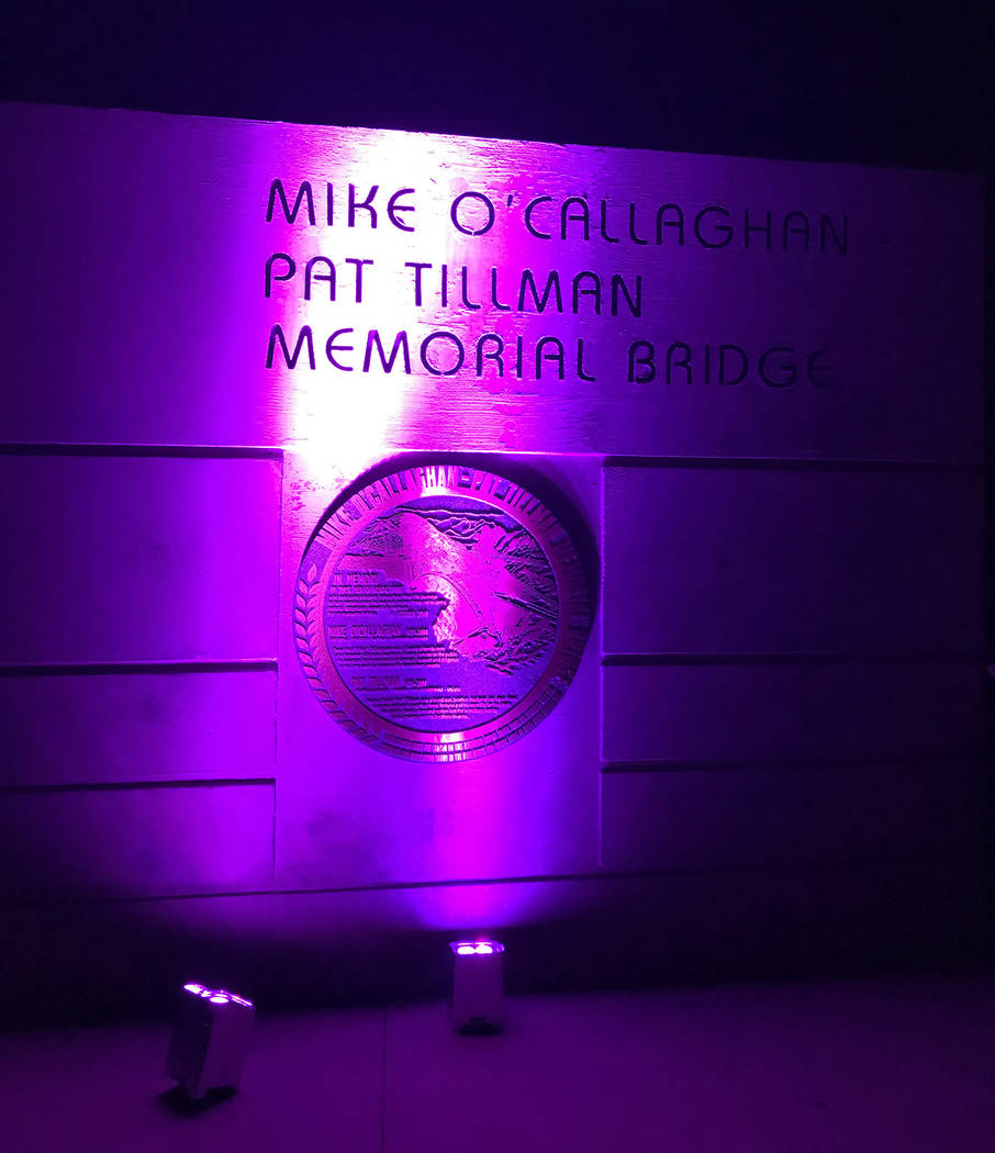 (Hali Bernstein Saylor/Boulder City Review) As part of the National Domestic Violence Awareness Month observance Hoover Dam was lit purple Monday, Oct. 29. The dam was visible from the Mike O'Call ...
