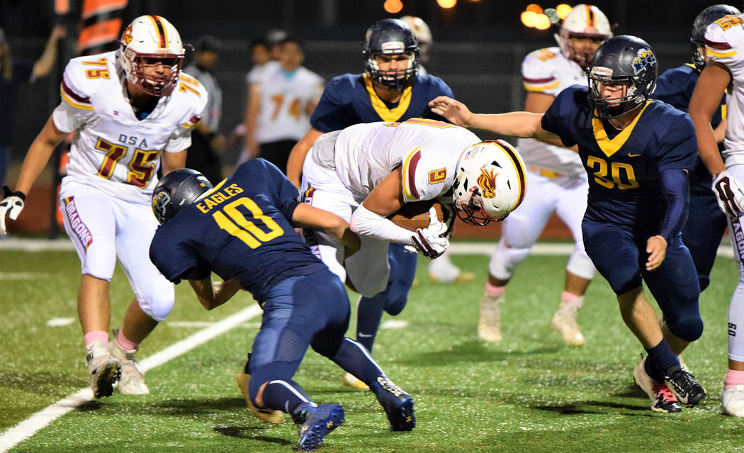 (Robert Vendettoli/Boulder City Review) Boulder City High School sophomore Matt Felsenfeld, left, and senior Jimmy Dunagan close in on the Del Sol ball carrier Oct. 25, 2018. The Eagles came from ...