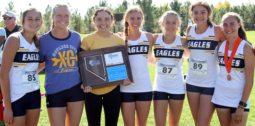 (Staci Selinger) Boulder City High School's girls cross-country team celebrates after winning the 3A Southern Region title Friday, Oct. 23 during competition at Veterans' Memorial Park.